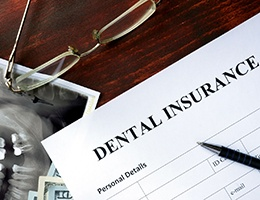 Dental insurance paperwork for the cost of dental emergencies in Ann Arbor