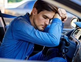 Man falling asleep in car