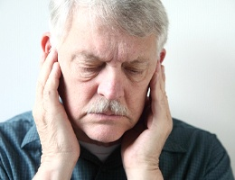 man with facial pain before TENS therapy