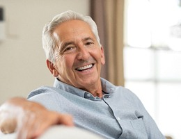 older man smiling after TENS therapy for T M J dysfunction