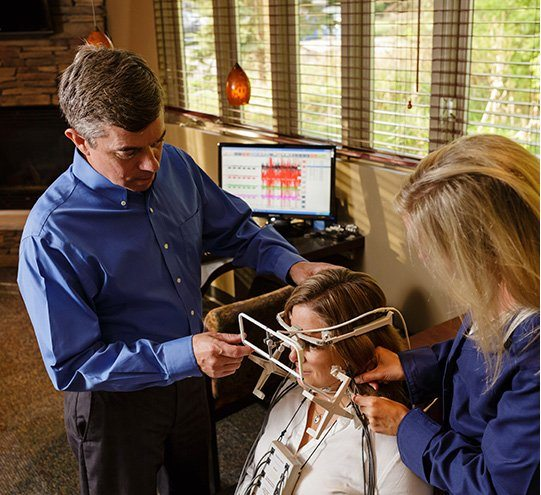 Ann Arbor dentist and team screening patient for TMJ dysfunction
